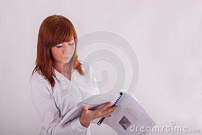 A young woman is reading a book