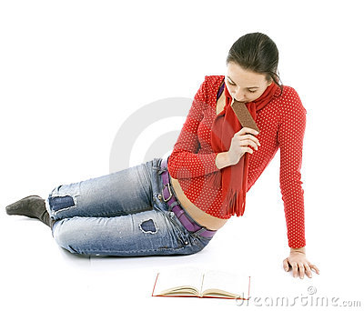 young woman reading book and eating
