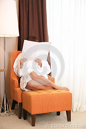 Young woman reading brochure in hotel room