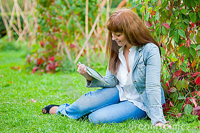 Young woman reading in tablet pc
