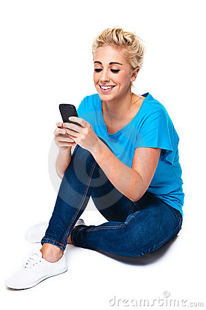 Young Woman Reading Text Message on Cell Phone