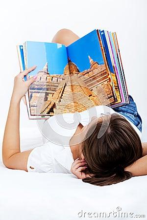Free Young Woman Reading Travel Magazine Stock Photo - 48919510