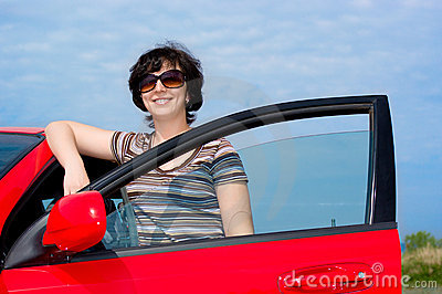 Young woman with red car
