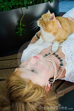 Young woman with red cat