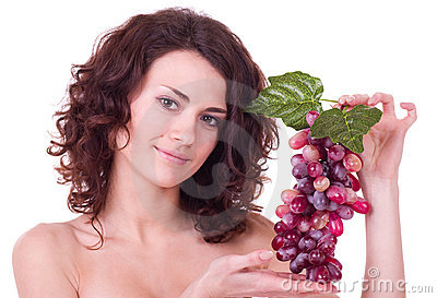 Young woman with red grape