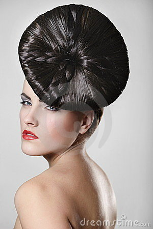 Young woman with red lips and unusual hair style