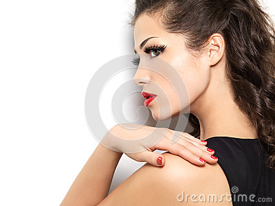 Young woman with red manicure and lips