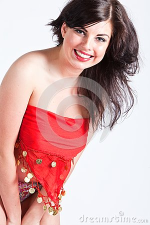 Young woman in red oriental shawl smiling