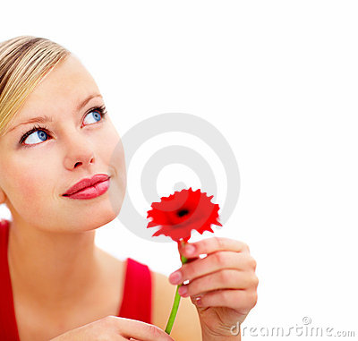 Young woman with red rose against white background