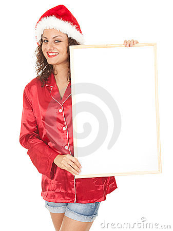 Young woman in red Santa hat with blank poster