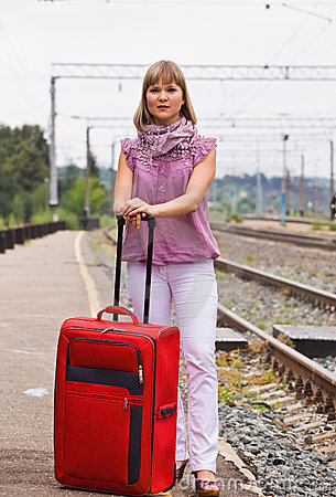 Young woman with a red suitcase