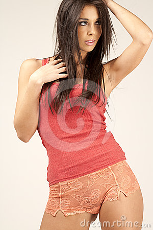 Young woman in red vest top
