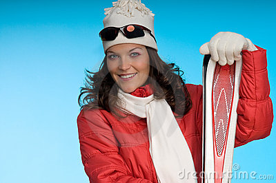 Young woman in red and white skiing outfit