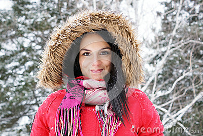 Young woman with red winter coat