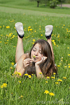 Young woman relaxation on grass