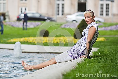 Young woman relaxes pondside