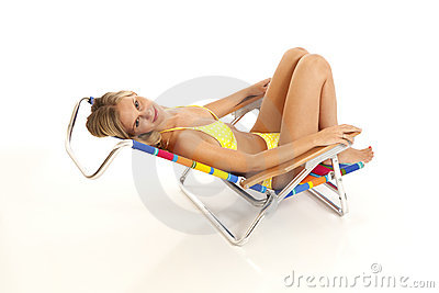 Young woman relaxing in beach chair