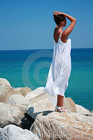 Young woman relaxing on the cliff