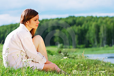 Young fashion woman in white shirt on nature