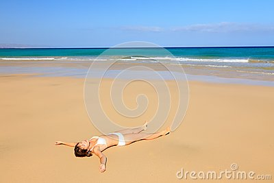 Young woman relaxing on ocean beach