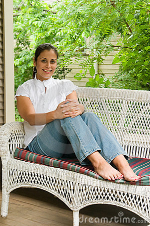 Free Young Woman Relaxing On Porch Stock Image - 2602591