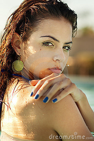 Young woman relaxing in a pool spa