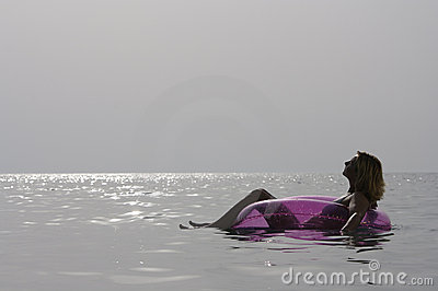 Young woman relaxing in the sea.