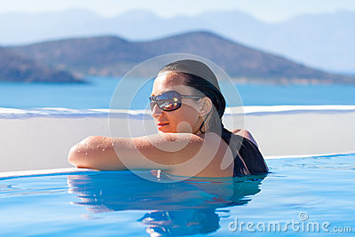 Young woman relaxing at swimming pool