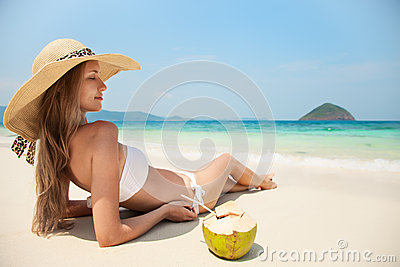 Young Woman Relaxing At Tropical Beach