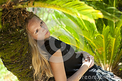 Young woman relaxing on a tropical resort