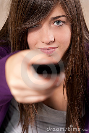 Young woman with remote control close-up