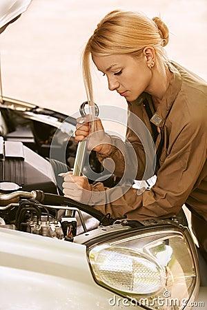 young-woman-repairing-car-24779189.jpg