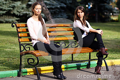 Young woman resting on a bench in the park