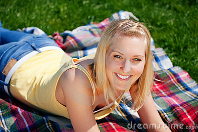Young woman resting on blanket
