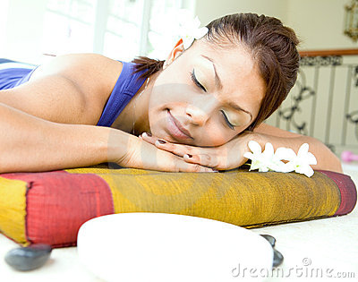 Young woman resting on massage bed