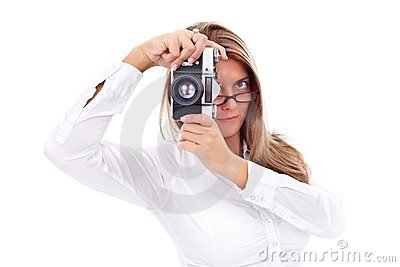 Young woman with retro camera