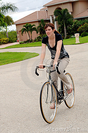 Free Young Woman Riding A Bike Stock Images - 5909164