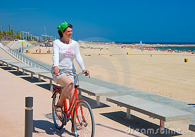 Young woman riding her bike