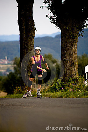 Young woman on rollerblades