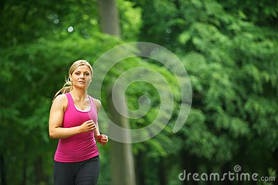 Young woman running in the park at her leisure