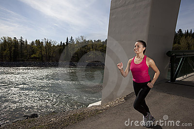 Young Woman Running Beside River