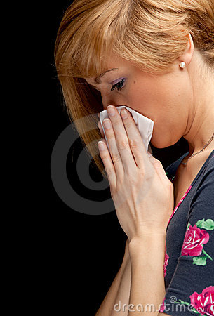 Young woman with a runny nose