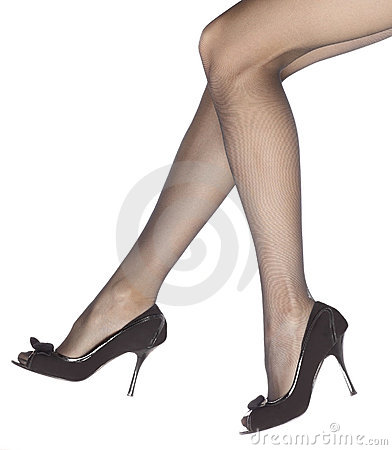 Young woman s legs in high-heeled black shoes