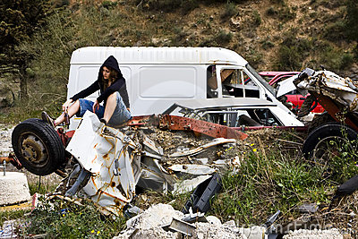 Young woman in the scrapyard