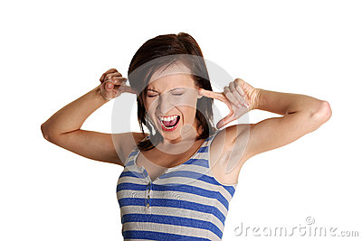 Young woman screaming with clogged ears.