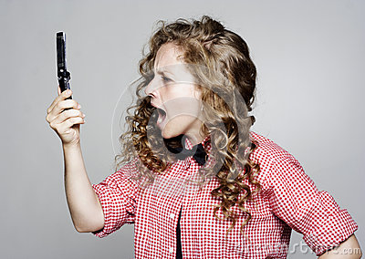 Young woman screaming on the phone