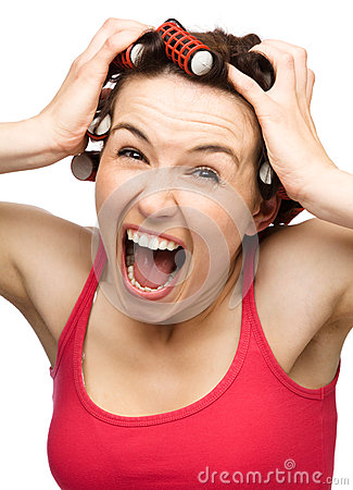 Woman is screaming holding her head with hands