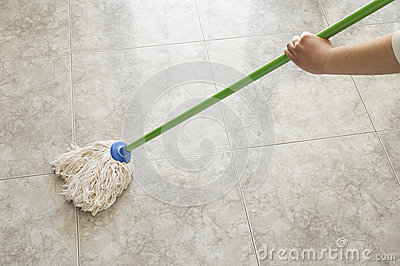 Woman scrubbing floor with a mop