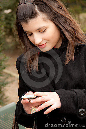 Young woman is sending a sms