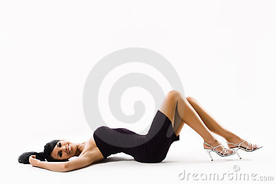 Young woman in sexy dress lying on back